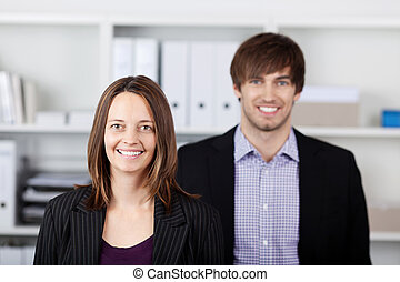 Young Businesspeople Standing In Office