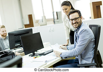 Young businesspeople working in modern office