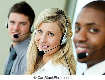 Young businesspeople working with headsets