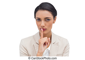 Young businesswoman asking for silence
