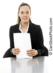Young businesswoman at a desk with papers in hand on white background studio