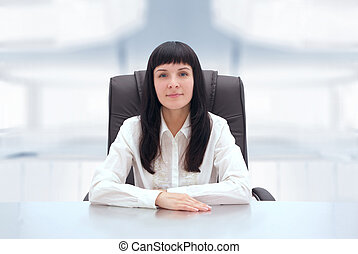 Young businesswoman at her office.