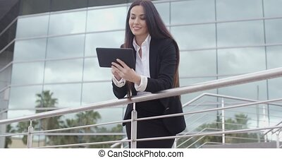 Young businesswoman browsing on her tablet