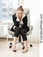 businesswoman choosing between comfortable and beautiful...