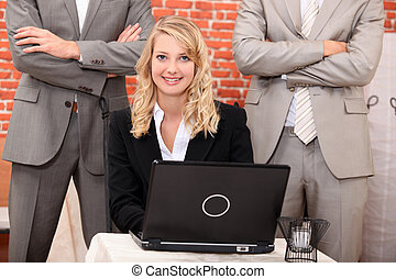Young businesswoman classy sitting in front of laptop