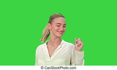 Young businesswoman dancing on a Green Screen, Chroma Key.