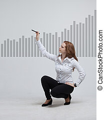 young businesswoman drawing graph