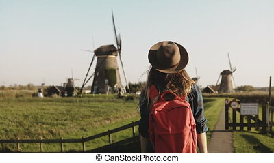 Young businesswoman feeling happy near a windmill....