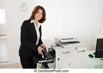 Businesswoman Fixing Copy Machine - Young Businesswoman ...