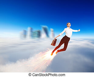 Young businesswoman flying like a rocket in blue sky.