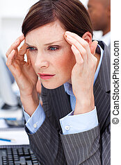 Young Businesswoman having a migraine