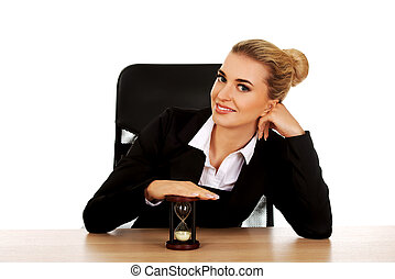 Young businesswoman holding a hourglass