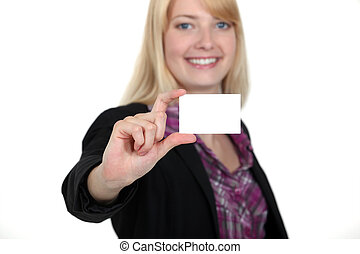 young businesswoman holding a visit card