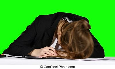 Young businesswoman in a state of stress, pounding his fist on the table. Green screen