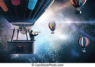Young businesswoman in air balloon with telescope