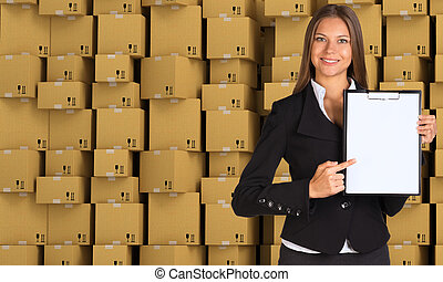 Young businesswoman in black suit with folder
