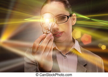 Young businesswoman in bright idea concept