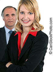 Young businesswoman in front of an older businessman