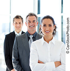 Young businesswoman in front of her team