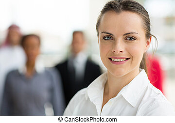 young businesswoman in front of colleagues