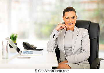 young businesswoman in office looking at the camera