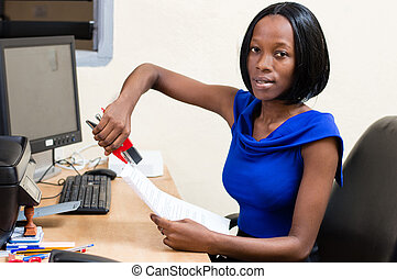 Young businesswoman in office.