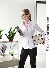 Young businesswoman in office