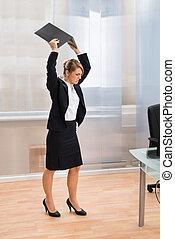 Businesswoman In Rage Throwing Laptop