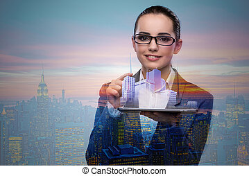 Young businesswoman in urban planning concept