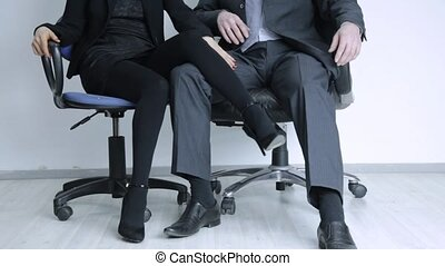 young businesswoman is sexually harassing to her boss. ...