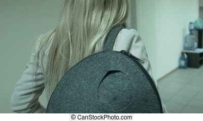 Young businesswoman leaves the office at the end of the day...