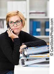 Young businesswoman listening to a mobile call