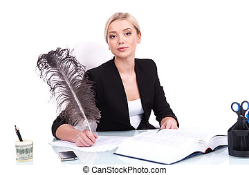 Young businesswoman looking into camera on white background. beautiful young woman writing at table using feather