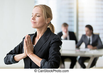 Young businesswoman meditating, habits of successful woman, ...