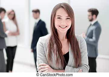 young businesswoman on a blurred background of the office