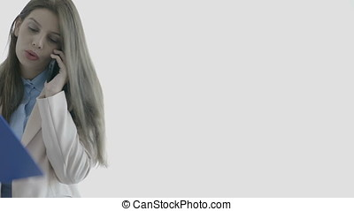 Young businesswoman over white background talking on the phone
