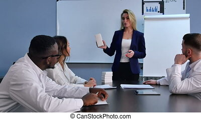 Young businesswoman presenting new tablets or pills to doctors