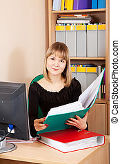 businesswoman reading  documents  in office