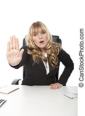 Young businesswoman saying - No - holding up her hand in a ...