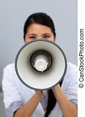 Young businesswoman shouting instructions