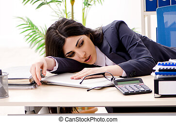 Young businesswoman sitting in the office