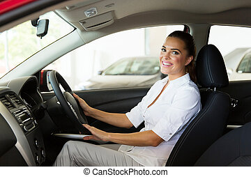 young businesswoman sitting inside the car