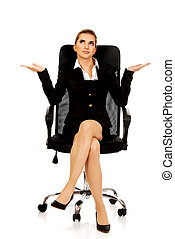 Young businesswoman sitting on a chair