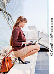 Young businesswoman sitting on stairway