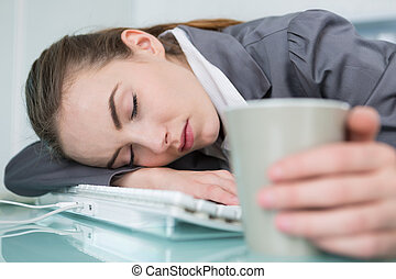young businesswoman sleeping in office