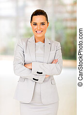 young businesswoman standing in office