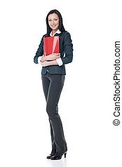 Young businesswoman standing with red folder. Looking at camera isolated on white