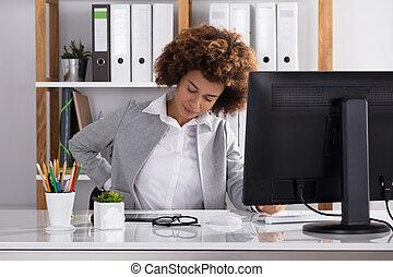 Businesswoman Suffering From Backache