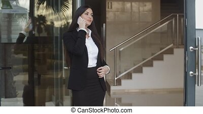 Young businesswoman taking a mobile call