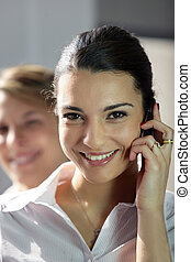 young businesswoman talking on her cell